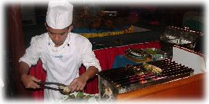 Chef cooking over open BBQ at Phi Phi Island in Thailand